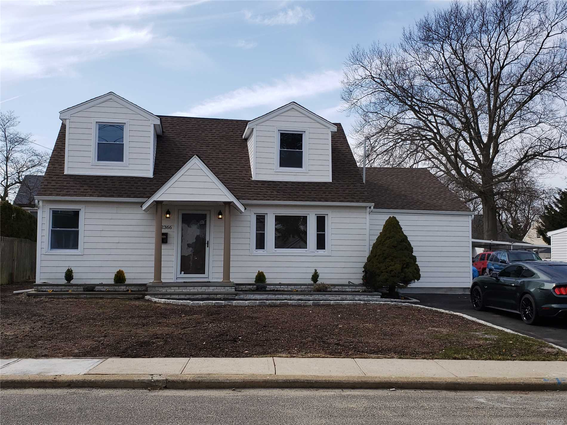 Diamond 4 bedroom Cape..Totally renovated. No expense spared. 2 new bathrooms, new roof, new siding, new windows, new gutters, new driveway, new heating system, new hot water tank, new driveway, newly upgraded 200 amp service, new ductless air conditioning system, gleaming hardwood floors, beautiful kitchen with granite and new S/S appliances. NOT in flood Zone(Zone X). Won't last! Call to schedule a viewing now! $499, 990