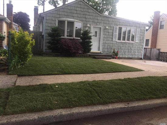 Bright and Airy living spaces. 2 Large Bedrooms, 1.5 Baths, Full Finished Basement; two-car driveway.