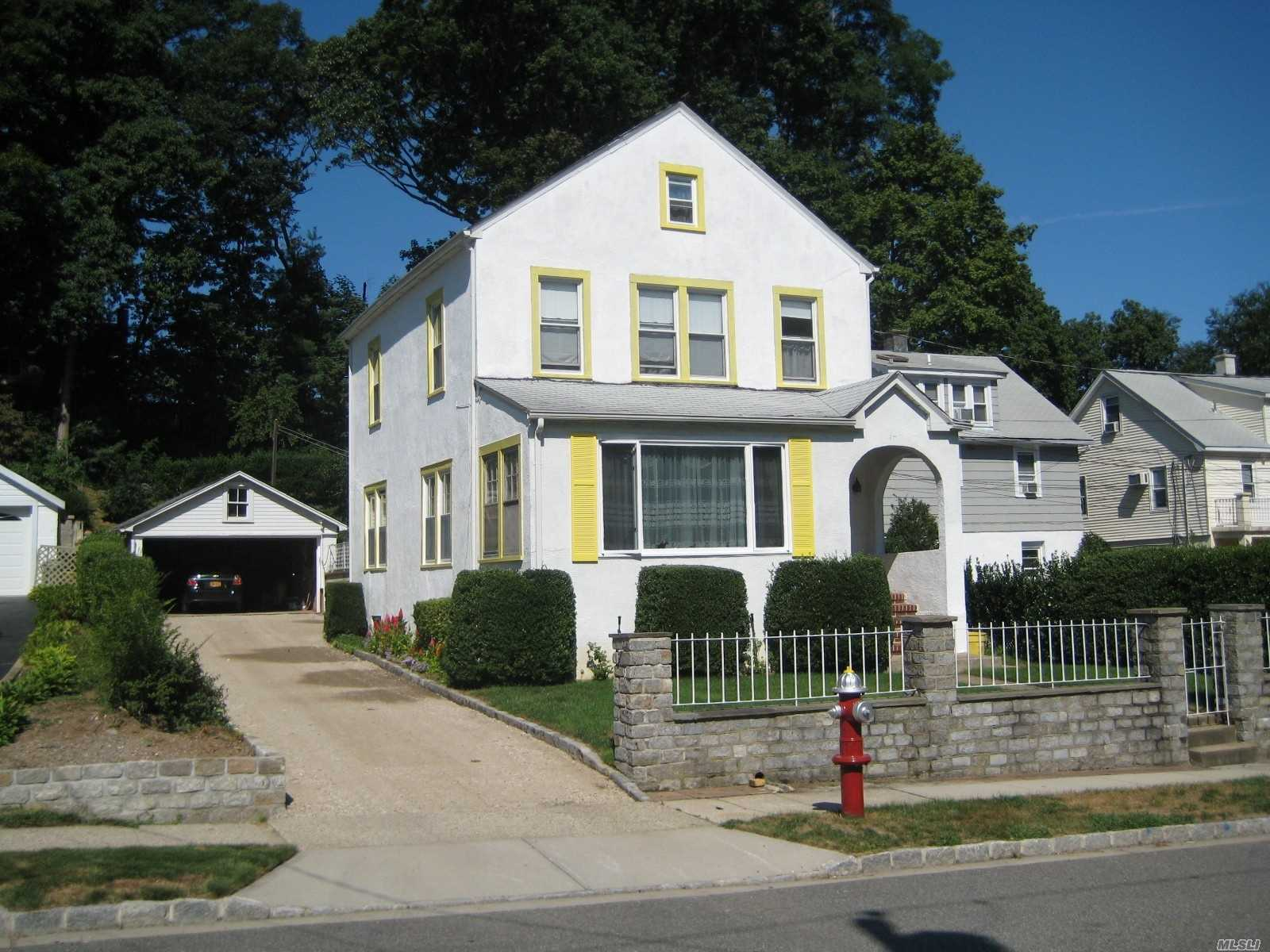 Updated 3 Bedroom Possible 4th Bedroom/Office Colonial with 2 Full Baths. Living Rm, Formal Dining Rm, Eat In Kitchen w/New Appliances. Hardwood Floors. Full 3rd Floor Walk-Up Attic for Storage. Unfinished Basement with Outside Entrance. Gas Stove, Gas Heat, Gas Hot Water. Patio and Beautiful Private Backyard.Two Car Detached Garage w/extra-long Driveway. Close to Beaches, Shopping, Transportation, Offices, Restaurants. Old-World Charm with Modern Amenities.