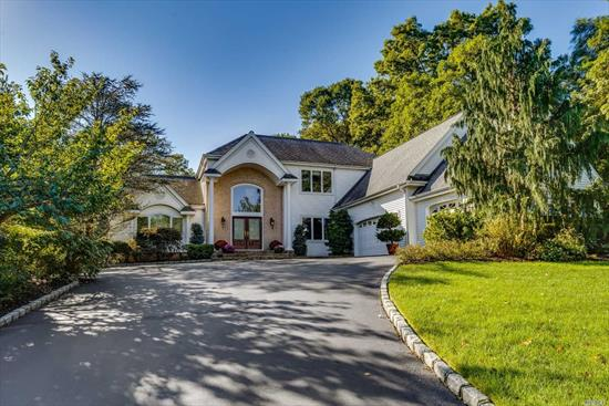 Stately post modern colonial beautifully situated on lush private property.Immaculate & expanded- this majestic home offers full guest wing on main floor.Soaring ceilings and gleaming hard wood floors beckon you through this gracious open floor plan.Expanded living space, 3 car garage.Fabulous basement with 9 ft ceilings.Best value in prestigious community-low HOA's-24 hr gated security, pool, tennis, playground, social rm.Freshly painted & ready for new owner.Award winning HHH Schools