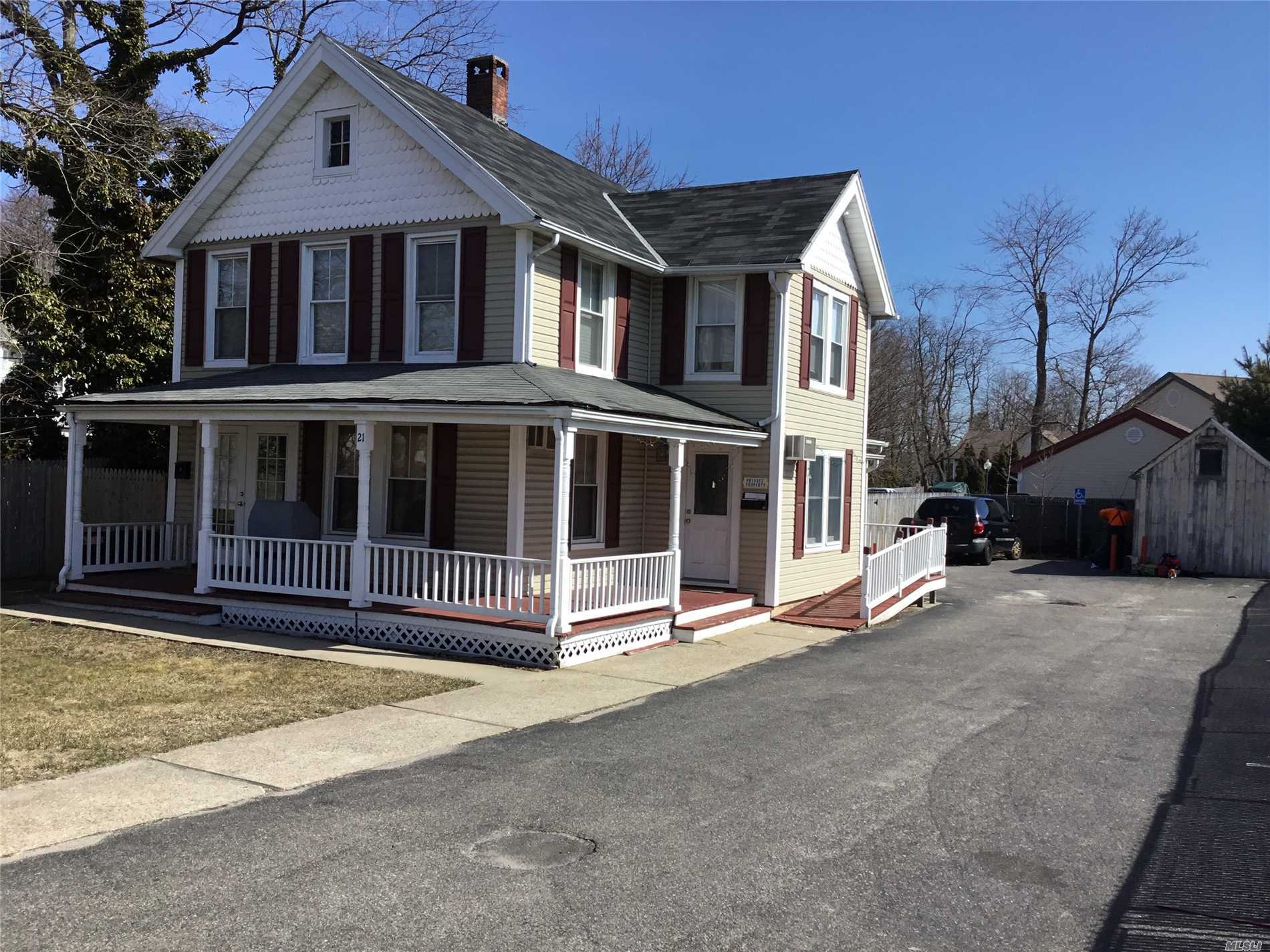 Legal Two in the Heart of Town. Completely Redone this December ( Kitchens, Baths, Flooring.) Updated Vinyl Siding, Roof and Windows. Maintenance Free home. Rocking Chair Porch. Great Investment