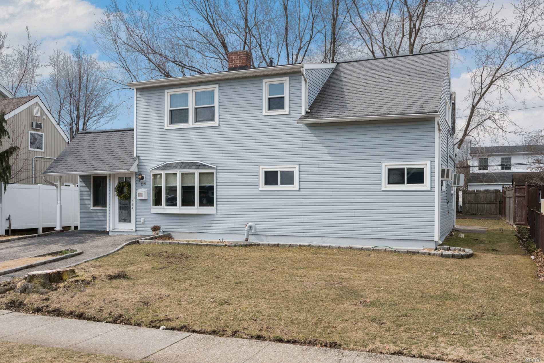 Beautiful Expanded Ranch Located Mid Block On A Quiet Street. Tastefully Updated Kitchen, Baths. Open Floor Plan, New Washer/Dryer, Many Updates. MUST SEE!