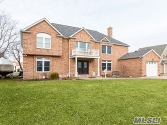 Beautiful Brick Colonial Sitting On Wide Canal 100 ft Of Bulkhead w/ fabulous waterviews, Spin Right Out Onto The open Bay! Enjoy LVR w/ frplc, Family Room w/ Bar, Radiant Heat Up & Down. Spacious rooms w/ intercom system in all rooms. Designer Granite EIK, Wood Floors, Jacuzzi, Great Surround System too! N/S, N/P