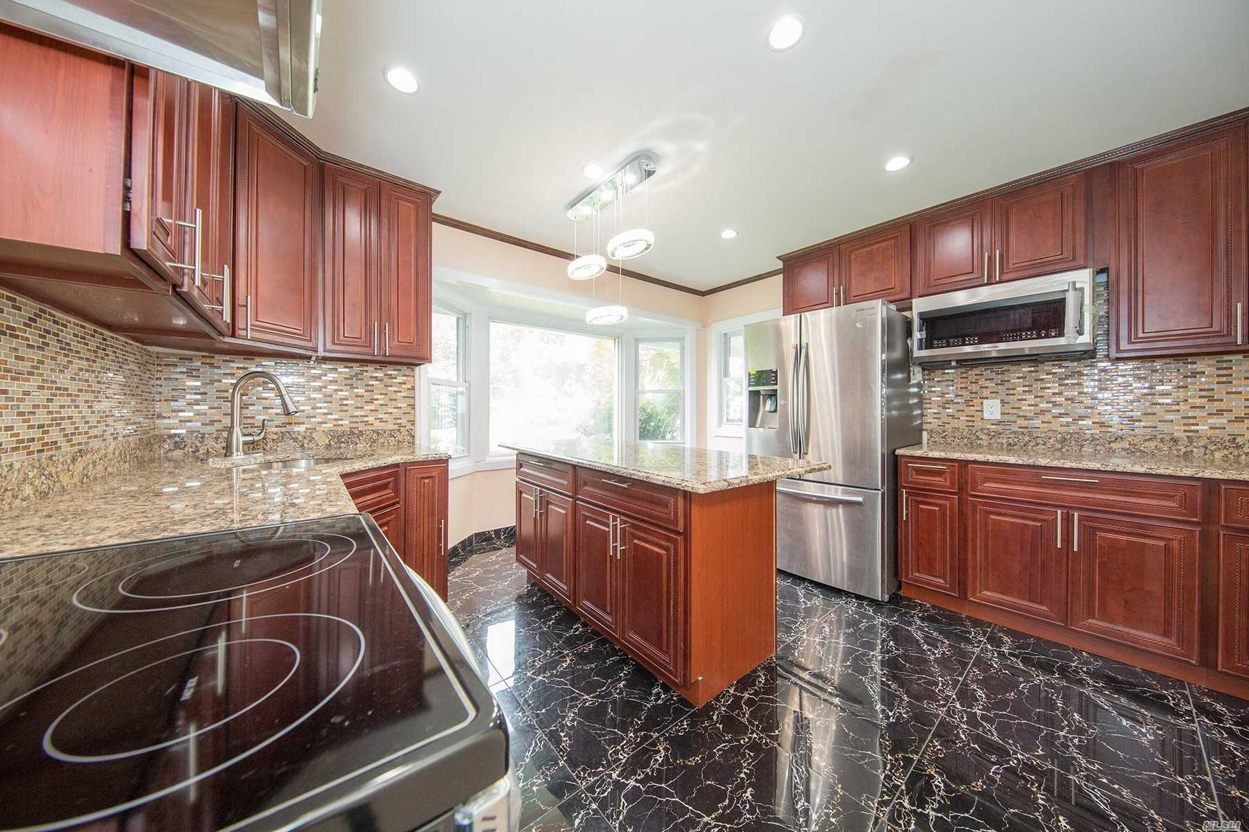 totally and recently updated house in the prime location of levittown, five bedrooms and two updated bathrooms, nicely updated kitchen with granite and samsung ss appliances.new central ac, extra bedroom in the garage.almost new roof.house can be used as mother daughter with proper permit.