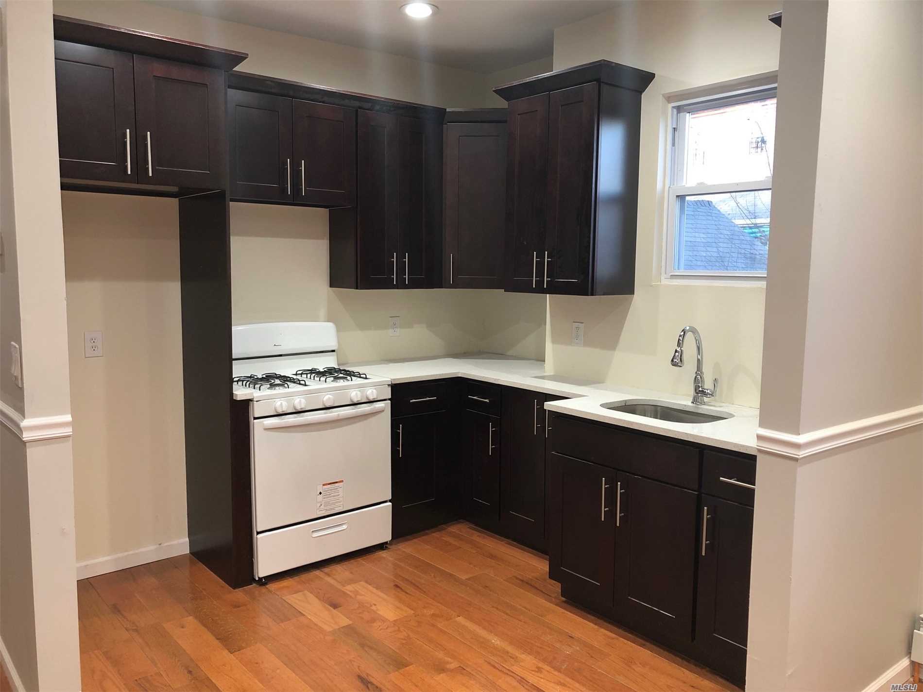 Beautifully renovated 3 bedrooms and 1 bathroom apartment. Brand new hardwood floors throughout. Turn key ready to make it your home.