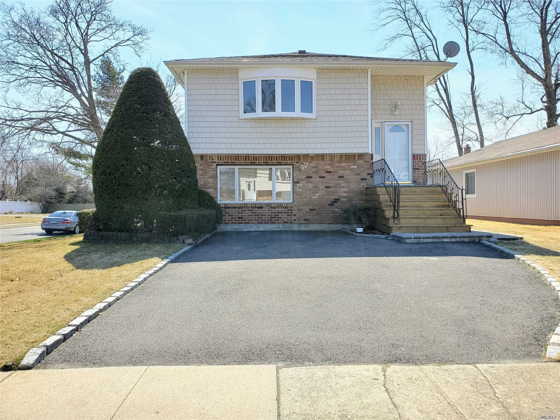 Great opportunity to own in Massapequa! 5 bedrooms and 3 full bathrooms, this Hi-Ranch has room for the whole family. Central AC keeps the house cool and on the outside vinyl fencing and a brick walkway leading to a patio is excellent for entertaining guests! Field of Dreams Park is walking distance up the road for the kids. Sunrise Highway, restaurants on Merrick Rd, and Sunrise Mall are within a 5-minute drive but still far enough to keep your home private from the bustle.