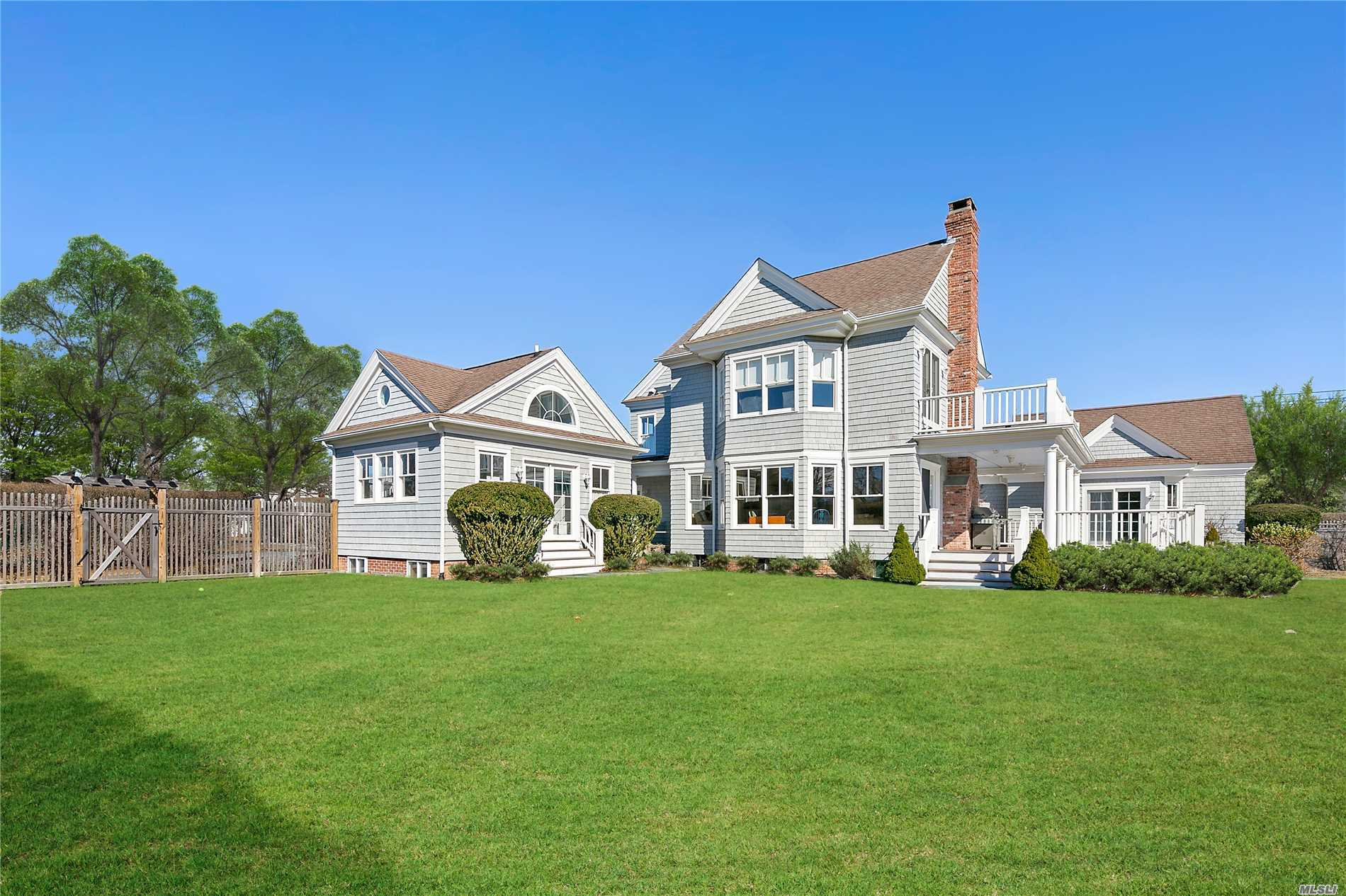 This magnificent three-story traditional home is quintessential Quogue. Set on .78 acres of manicured grounds. Full renovation completed in 2002. Gourmet kitchen with top of the line appliances opens to family room with fireplace. Additional 1st floor family room could be a Master Suite. Library with fireplace. Grand 2nd floor master with sitting area/office and private deck. Three bedrooms and 2 baths. 3rd floor has 3 bedrooms and bath. Gunite pool, pool house with bath and art studio.