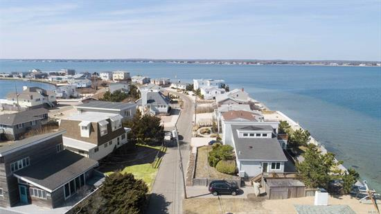 Magnificent water views, bring your toys down to the bay or ocean then finish your day off with watching the sunset. This 4 bedroom 3 bath lovely home is just waiting for you. Vaulted ceilings, wrap around deck and even an outdoor shower. Fantastic Rental Potential!!! This home needs you and some TLC. With proper permits you can put in a plunge pool, hot tub and second story deck. Our sellers are motivated and are ready to move on so you can move in and start enjoying life in The Hamptons.