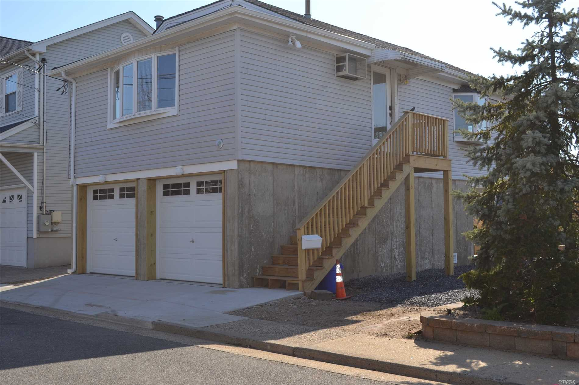 Waterfront Raised home with One car garage included. 2 B/R, 1 and 1/2 Bathroom, L/R, D/R, Washer and Dryer