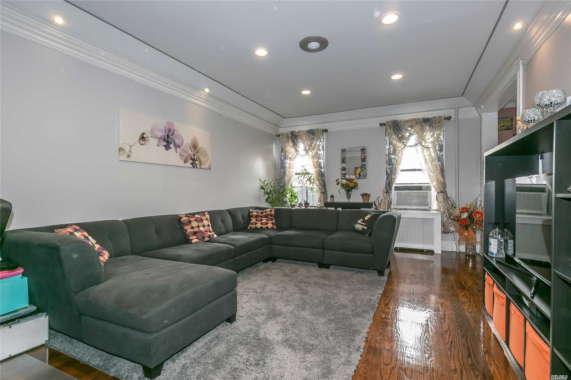 Spectacular, Bright and Spacious 1 Br/1 Bth , Front Facing Pre-War Coop Apt With Beautiful Garden View. Washer-Dryer in Unit! 12 Feet High Ceilings With Double Moldings, Elegant Oversized Bedroom Custom Eat-In Kitchen With Top Of The Line Stainless Steel Appliances & Granite Counter Tops, Beautiful Italian Marble Bath w/Window, Immediate Out. Parking, Close Proximity To LIRR With Direct Line To Penn Station, Shopping Center & Restaurants. Enjoy Access To Parkwood Pool, Tennis Ct, GN South SD