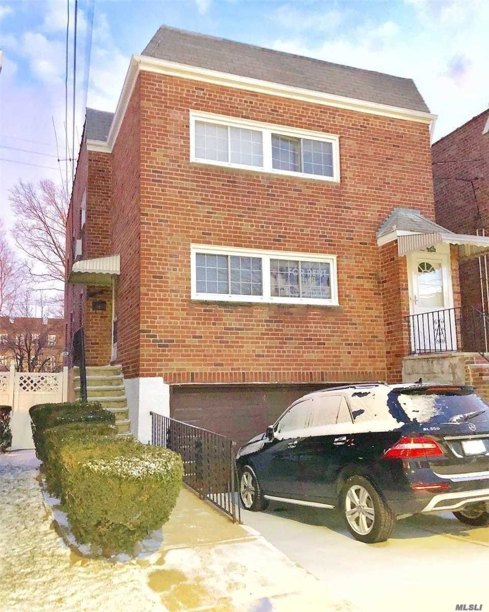 Bayside ***DUPLEX*** This is a must see *Entire main flr & full finished basement w 2nd kit. Prime Location 1/2 blk to LIRR Bayside *Modern & fully Renov'd apt 3 full Bdrms 3 full bths w 2nd bth stand up shower on main floor & *Fully Renovated Kit w SS Appliances Inc dishwasher Hardwood flrs & ceramic tile thruout *Full Finished bsmnt has lg open area, laundry & sliding doors to bkyd & access to 1.5 car gar & 2 car dvway Bk Yard fully fenced. Approved pets case by case.