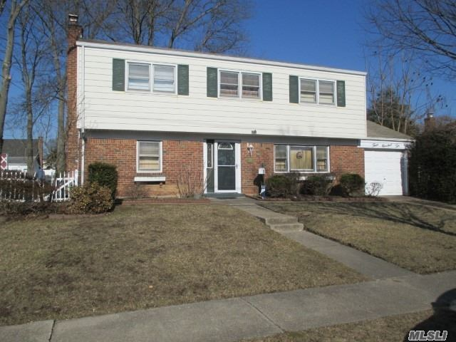 Spacious Split Level w/Hardwood Floors, Cathedral Ceiling In LR and Dining Room,  1 1/2 Baths, Ample Closet Space, 75 X 100 Property. Convenient to Shopping, Schools, and The Long Island Railroad.