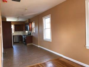 Gorgeous 2 Br, totally renovated. Hardwood floor, central air, granite countertops.  Hook ups for washer and dryer.  Parking on street Tenant pays all utilities including their share of water No pets No smoking Refrigerator and dishwasher included