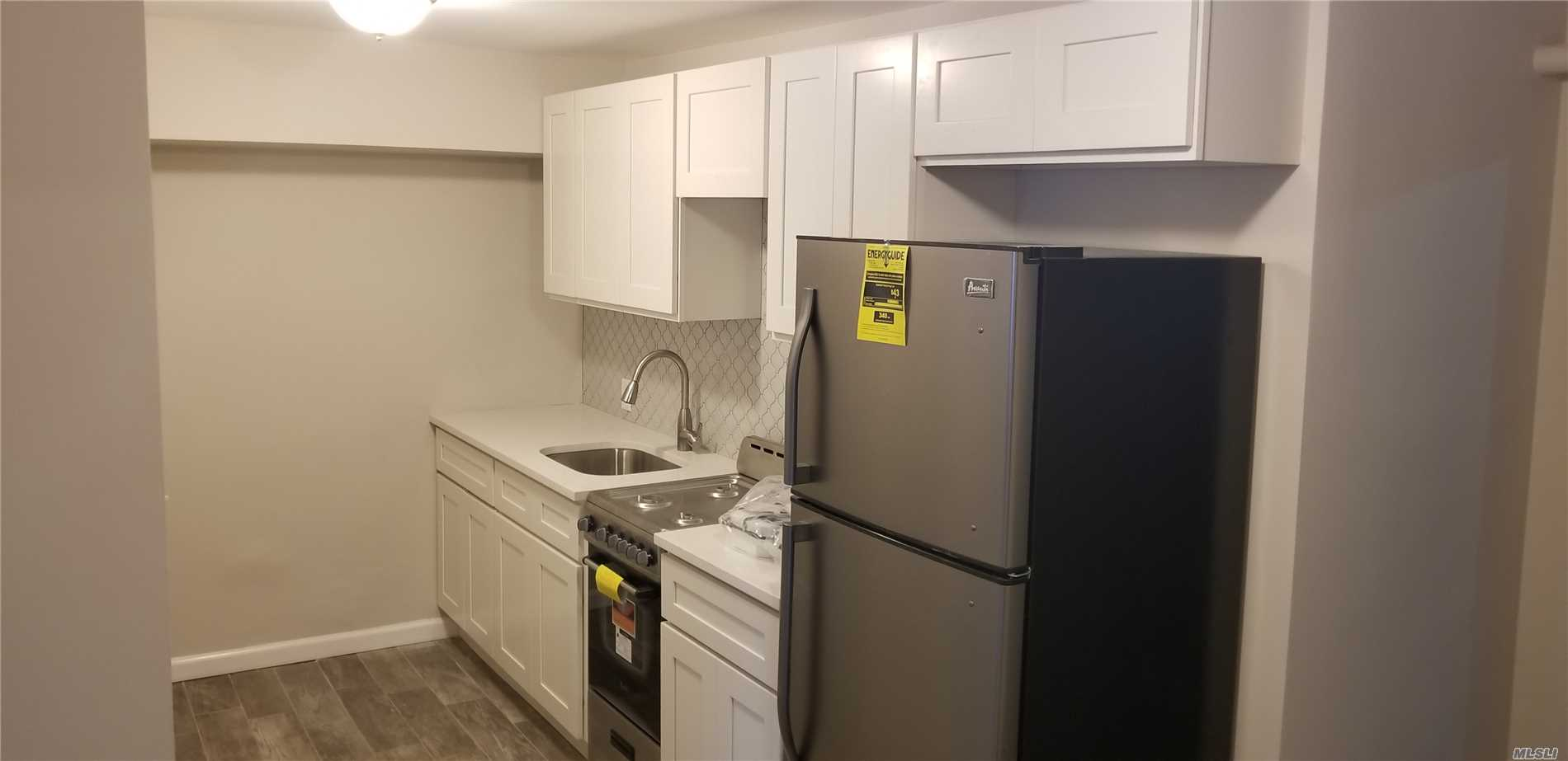 Bright & Fully Renovated with New Kitchen, Quartz Counters and Stainless Steel Appliances. New Bath, Hardwoods In Bedroom. New Tile Floors, Doors & Painted. Patio & Garden Off Living Room. Close to Queens Blvd, Minutes To Subway M/R Train, Q58/Q59/Q60, Grand Ave & Elmhurst Hospital.