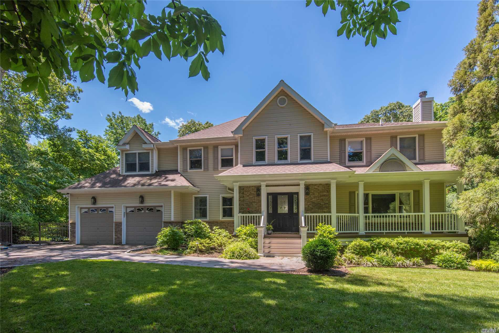 Move right in to this 2018 updated Colonial w/ front porch set back on treelined street. Luxurious master en-suite w/ dual closets & bath w/ radiant heat limestone floors & air jet tub. Two car garage & laundry/mudroom off eat-in kitchen w/ glass sliders that lead to Timbertech deck, pool, jacuzzi & patio. Finished lower level w/ built-in bar, wine cellar, den, stereo system & walk-out entrance. Perfect for everyday enjoyment & only minutes to Huntington Village & beaches. Auto Generac Generator