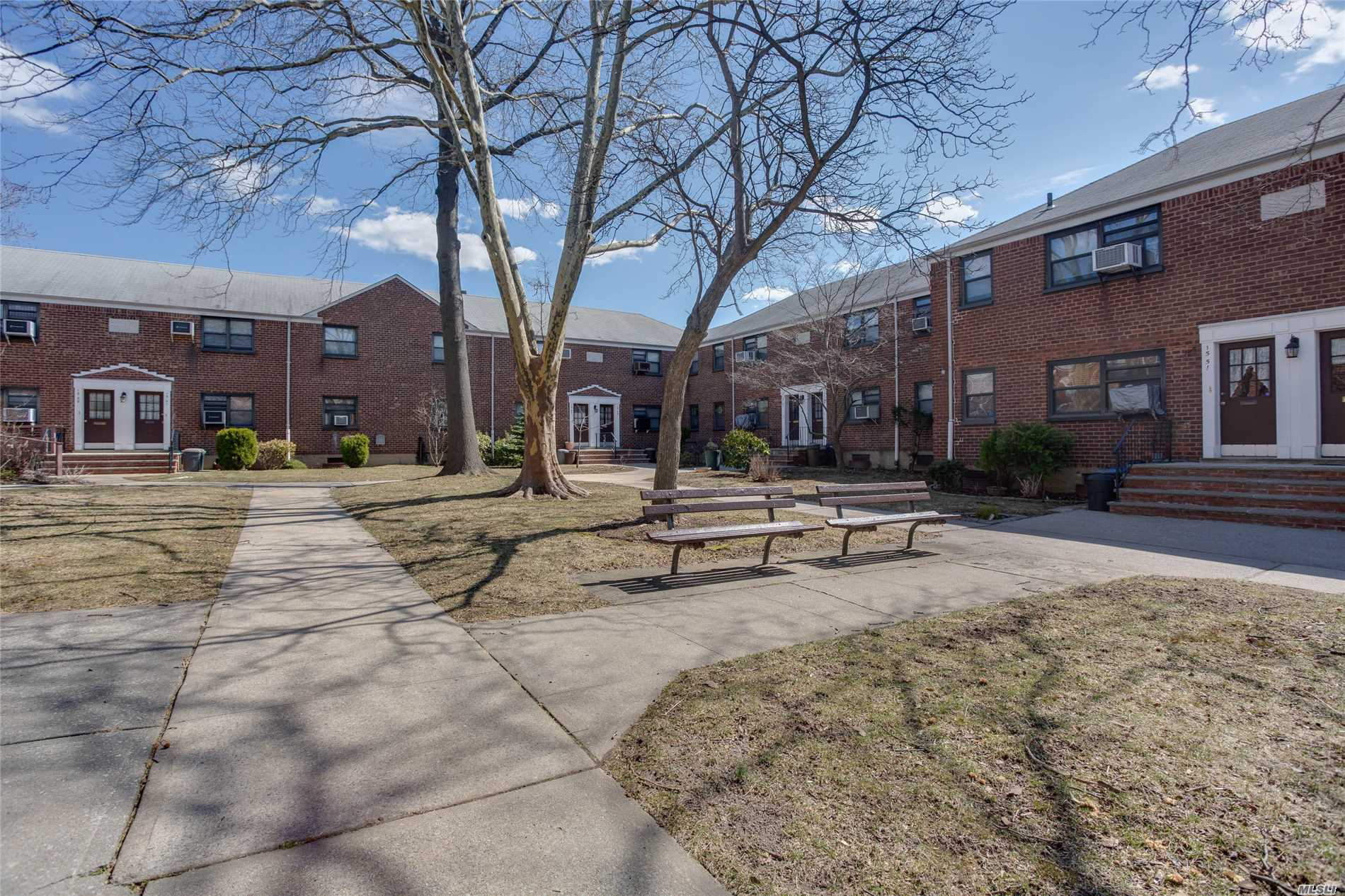 Sun filled Charming UPPER corner 1 bedroom in move in condition located in private courtyard. Gleaming hardwood floors throughout, Beautiful woodwork, hi-hats and more. Spacious walk-up attic, . Close to express bus to the city, Flushing. Easy access to highway!~near shopping. Move right in and enjoy the convenience and location of Clearview Gardens.
