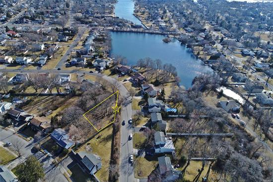 Vacant piece of land available immediately in prized location - Beach Middle School - non flood zone - wonderful neighborhood. Recently subdivided one third of an acre adjacent to lake front homes. Spectacular opportunity to build a brand new home in a prestigious location!