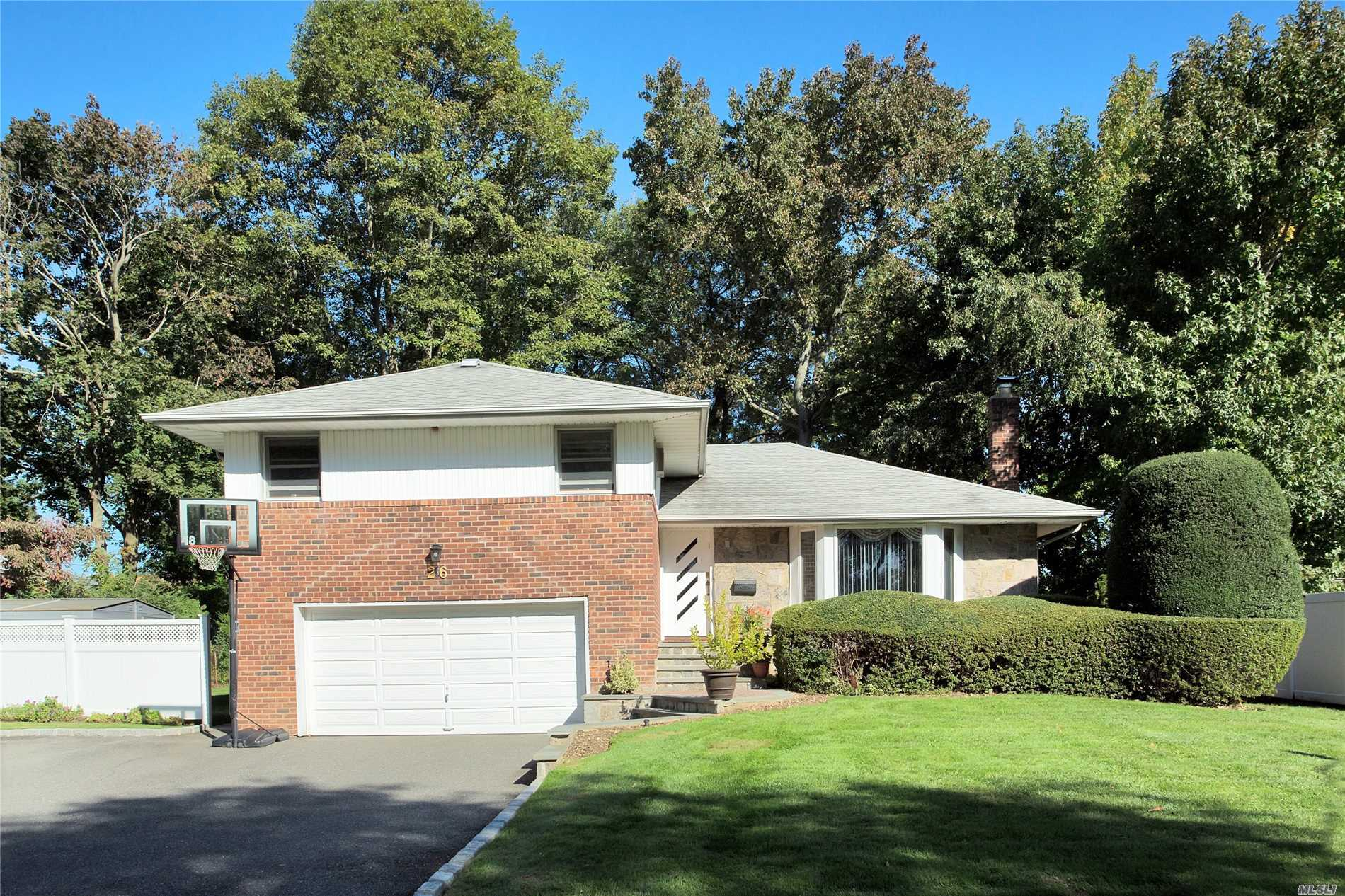 Bright Expanded Split w/Renovated EIK w/SS Appl. & Quartz Counters and Vaulted Ceiling w/Skylites, Gas Cooking, Anderson Windows, HW Floors, Oversized Flat Property w/ Deck and Patio w/New Pavers. Baylis Elem, Thompson Middle, Syosset HS