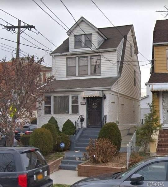 Great Corner Property, Solid House Needs Updating, Huge 2 Car Garage. Great Location 1 Block From Ps 163 Elementary School, Kissena Park, Bus Transportation, 4 Blocks From Queens College.