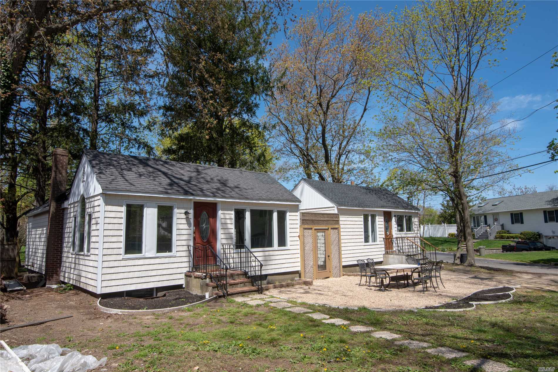 Legal Duplex:Perfect Summer Retreat or income producing Property just 2 blocks from beach ent.live in a completely renovated 3 bed 1bth home w/new hardwd flrs, brand new Kit & bth, cathedral ceilings, 200 amp elec & than walk thru your courtyard to the identical home which is a perfect rental or place for Mom.Yard is large and level & has a detached 1.5 car gar.Other features; 6 yr triple ring cesspool, 2nd home is freshly painted w/new carpeting and ready to be rented !! 2 burners (8yrs & 4yrs),