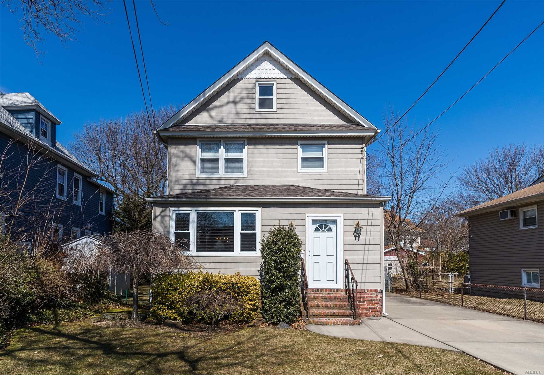 Pristine Colonial on Quiet Street in Walking Distance to Elementary School (#2), and Local Commerce. Beautiful Entry Foyer w/Gorgeous Moldings, Frml LR, DR, Chef's Kitchen w/Top of Line SS Appliances, Full BA, Great Room, Overlooking Large Deck & Private, Deep Yard. Second Flr has Large Mstr BR, 2 BR, & Over Sized Family BA, Walk Up Attic w/Great Storage. Basement Consists of Rec Rm, Utilities. All New Windows Throughout Home.