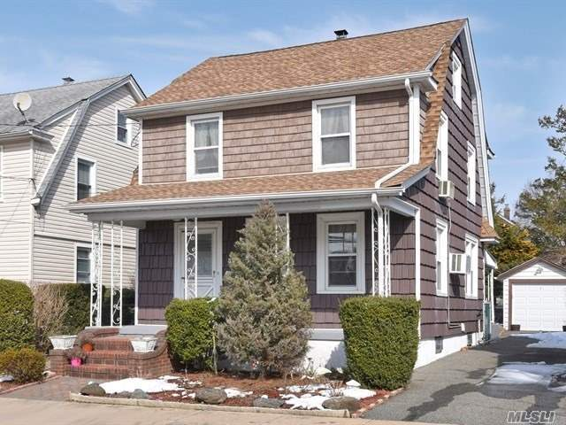 Lovely and charming Dutch Colonial with lots of natural light situated middle of the block This home offers an open floor plan, updated kitchen w/Vlt. Ceiling and skylight. Updated baths, dbl pane windows,  front and back open porch and sep. patio. Close proximity to shopping, LIRR, etc.
