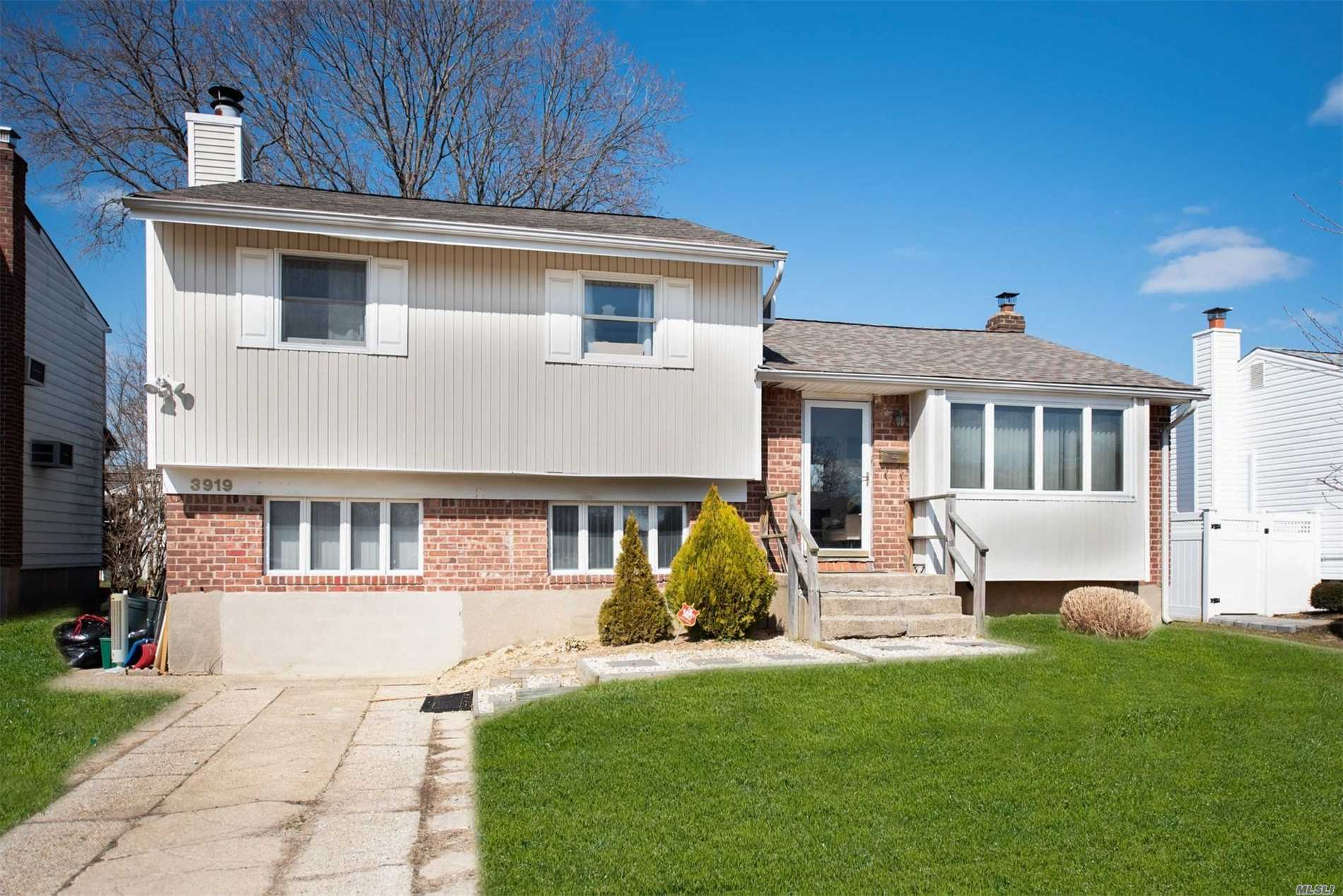 Splendid Seaford 4 Level Split. Newer roof, new alarm system. 2 Full Baths, 1 of them new with a Quartz countertop. Levittown Schools. 3 nice sized bedrooms, family room or den, and an office. Mid-block location. Close to parkways, shopping, beach & golf.