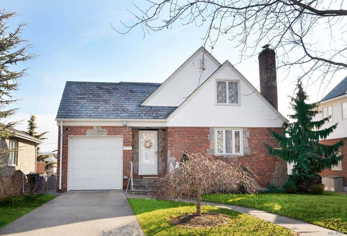 Beautiful Cape on a large 50x100 lot in desirable Whitestone. This Home Features 3 Bedrooms With Space For A 4th. Master On 1st Floor, Updated Bath, E.I.K., Formal Dining Room, Sun Drenched Living Room. Hardwood Floors Throughout, Fireplace, And Yard With A Patio And Pavers. Full basement, gas heat and In Ground Sprinklers on a quiet block.