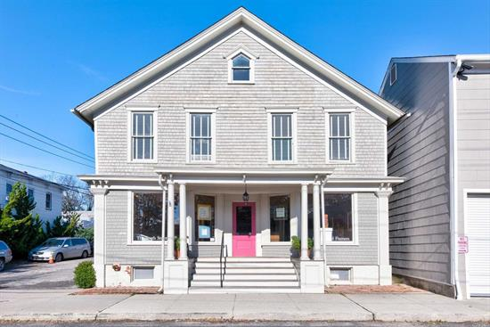 Commercial building in the heart of Greenport Village in mint condition offering multiple retail spaces & 2nd floor apartment. 1st floor: covered porch, retail space with 2 display windows, kitchenette, office, full bath. 2nd floor: large studio, half bath, 1-bedroom apartment with full bath & rear balcony & separate entrance.