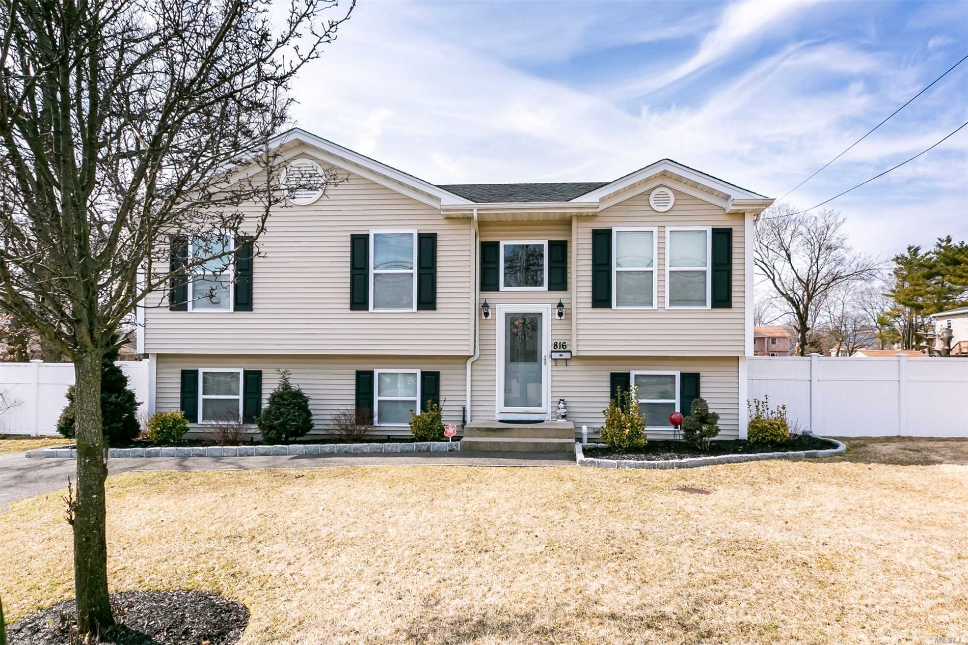 Beautiful Large 5 BR, 2 Full Bath High Ranch Built New In 2009 - This Home Features Gleaming Hardwood Floors, Open Floor Plan, Kitchen w/Granite Counter-tops & Full Dining Area, Downstairs Has High Ceilings w/Exit to Outside, MANY POSSIBILITIES- Taxes w/ STAR $8832.00