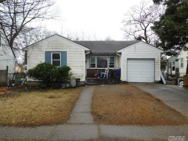 Three Bedroom Ranch On Quiet Mid-Block Location In Need Of Your TLC! A Great Handyman Special! Attached Garage, Full Basement & Tons Of Potential!