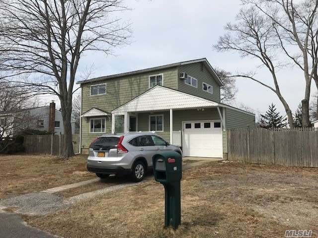 Center Hall Colonial 4 Bedrooms, 2 baths, Brand New Custom Kitchen with Stainless Steel Appliances (Being Put In Now), New Windows, Vinyl Siding, New Electric, Full Basement Partially Finished & Garage. Plenty of room for Mom!!