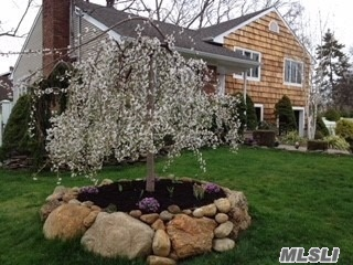 Happy Spring! A HHH Beautiful split level on an o'sized lot w/ specimen plantings.Perfect for both indoor or outdoor entertaining: this home has a wonderful flow. Snuggle by the WBFPL, Enjoy the bar in the den & the privacy of a MBR Suite.Many surprises in store~come see for yourself! THIS IS A GOLDEN GEM!