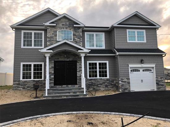 Brand-New Custom *Waterfront* Center-Hall Colonial Being Built In The 1st-Class Massapequa Shores Neighborhood & On Pristine Block Filled W/ Nice Homes! Built By Builder Of 30+ Yrs/350+ Homes. Home Features: Custom Kitchen & Vanities W/ Ss Prof Appliances, Pella Wdws, Sophisticated Moldings Throughout, 1.5-Car Gar, 1st Flr Bdrm/Office, 3 F-Baths, & Large Master Suite W/ Balcony & 2 Wic's & Fbath+Jacuzzi, +++Much More!