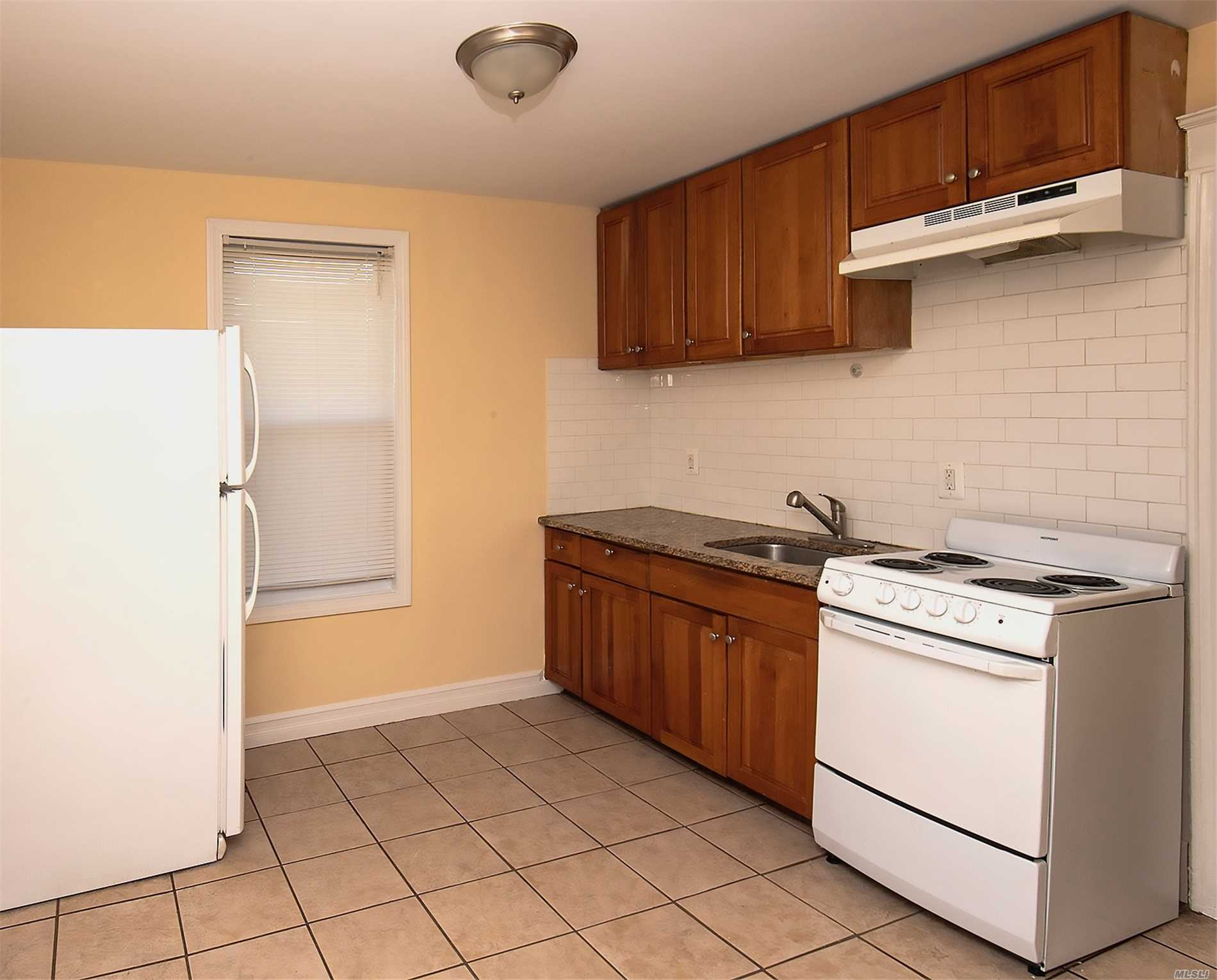 Lovely Apartment Located On The 2nd Floor. There Is 1 Large Master Bedroom, A Kitchen And Bath, Includes Use Of The Backyard And Driveway. Excellent Location For Public Transportation And Shopping. Tenant Must Maintain The Grounds.