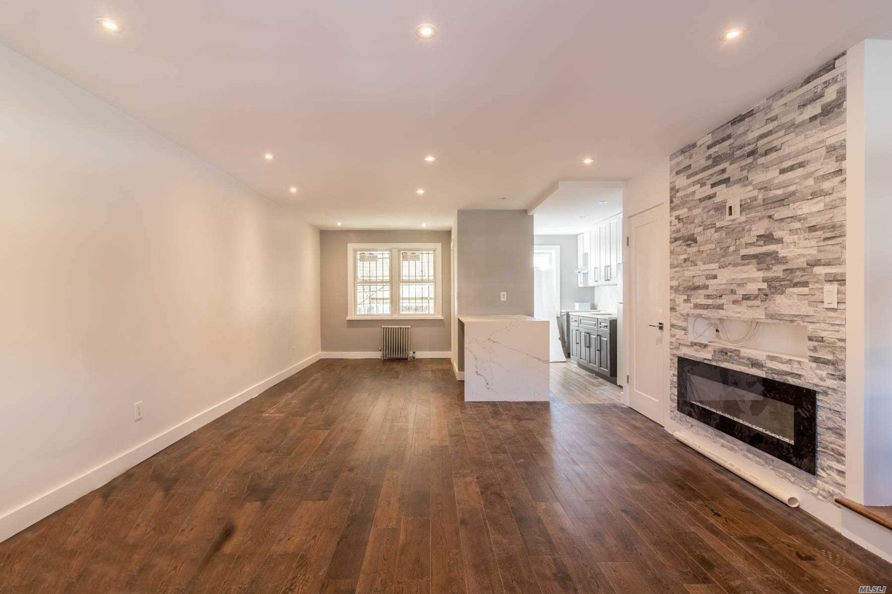Immaculate fully renovated brick home in the heart of E. Elmhurst. Brand new hard wd floors, custom combo kit w/granite counters and s.s. apps. LR w/custom frpl, recessed lights throughout. Large above ground bsmt with 2 entrances! Huge private backyard, half block to transportation, school, and more! Must see!