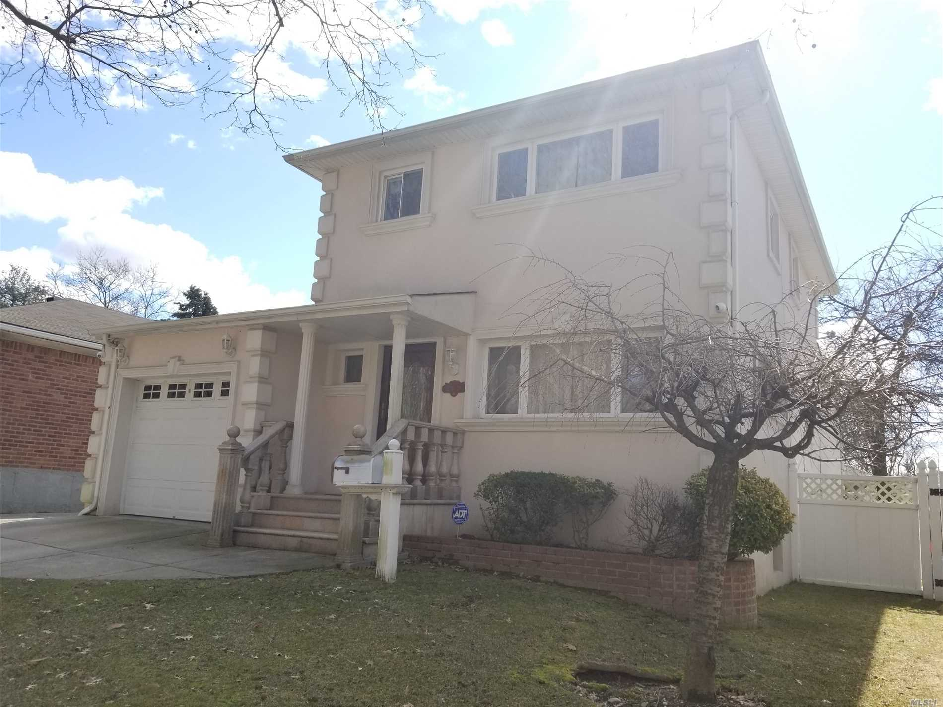 This is a True Gem in Oakland Gardens, Gorgeous Stucco finished colonial in front of the Alley Pond park, Very quiet location, Enjoy the four seasons of nature from your living room, Cathedral ceiling family room with a fireplace has bay window and sliding door to deck, High ceiling finished basement with side entrance, All fenced private backyard, Cement patio, SD#26, P.S. 188 kingsbury, Convenient transportation, bus Q88, QM5, Q27 to flushing, Must See Your Next Home Sweet Home
