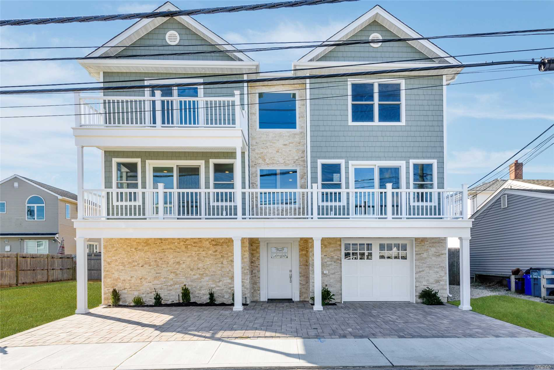 stunning new beautiful colonial home fema compliant, desirable canals location. features all new state of the art finishes; the finest quality craftsmanship, master bedroom suite w/cathedral ceiling, deck, gourmet kitchen w/quartz countertops & stainless steel appliances, top of the line finishes, living room w/deck, formal dining room w/deck & hardwood floors throughout, anderson windows, 2-zone central air & 1200 sq ft garage+storage. beautiful yard! taxes to be independently verified.