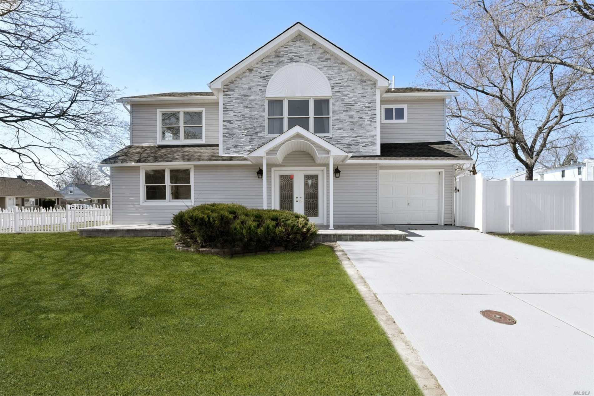 Magnificent Colonial On A Well Landscaped Property In Bethpage. .This 5 Bedroom, 3 Bathroom House Has Been Completely Remodeled.Updated Kitchen With Stainless Steel Appliances, Hardwood Floors, Custom Bathroom's, Walk In Closets, En-suite Master, Fenced Yard, Low Taxes And A Lot More. Overall Generous Amount Of Living Space And Stylish Finishes. This One Is A Must See.