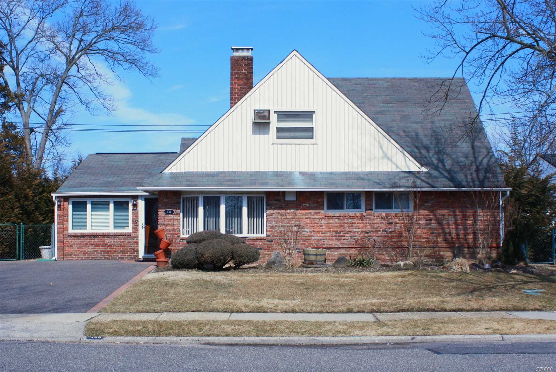 DISTINCTIVE MINT UPDATED EXPANDED CAPE, 3 OR 4/5 BR'S, *1ST FLOOR MBR, DINETTE, F/DR, F/LR, EIK, 2 AC'S, FP,  NEW BATH. FULL 1ST FLOOR REAR EXTENSION APPROX 15X32, 2 SKYLIGHTS CATHEDRAL CEILING, ALL ROOMS FORMAL SIZE, WOOD FLOORS, NEW GAS BOILER, NEW A/C'S, ANDERSON WINDOWS, STORAGE ROOM 2 REAR ENTRANCES,  ATTIC STAIR. ** FULL 2ND FLOOR MASTER BR SUITE, 2 SKYLIGHTS, 2 A/C'S NEW BATH, OFFICE, XL CLOSET SPACE.