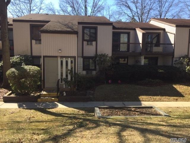 Gated Community. Open Floor Plan, Large Rooms. Private & Secluded. This 1 Bedroom, 1 Bath Condo Features Hardwood Floors, Sliding Glass Door To Patio, Laundry, Large Walk In Closet In The Master Bedroom, New Windows, and 2 New Air Conditioners! Great amenities. Close To LIRR, Suny College, and Mall. HOA Fee is $455 Monthly.