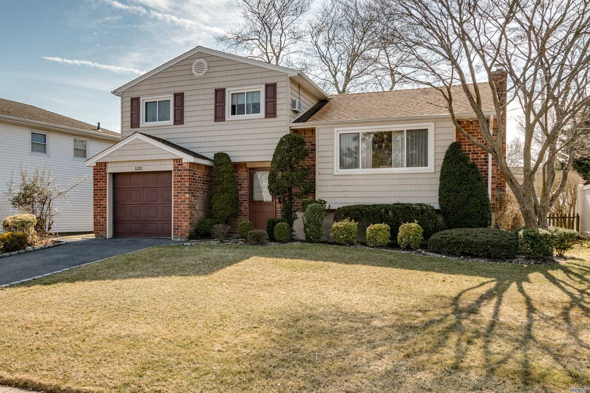 *The AMERICAN DREAM*, You can have a Vynl/Brick 3 Bedroom, 1.5 bath Split Level home set on a quiet, tree lined street in Wantagh Forest Lake Schl (Sd#23) located in Holiday Park on 6000+ sq ft lot, home features Frmal diningrm, spacious entertainers livingroom, delightful sun-lit- eat in kitchen that over looks a private secluded yard, family room, basement, New Gas Boiler heat+h/w, washer/dryer main level, kitchen 'as is'-price reduced( because of this)/.low, low taxes, close to schools, houses of worship.