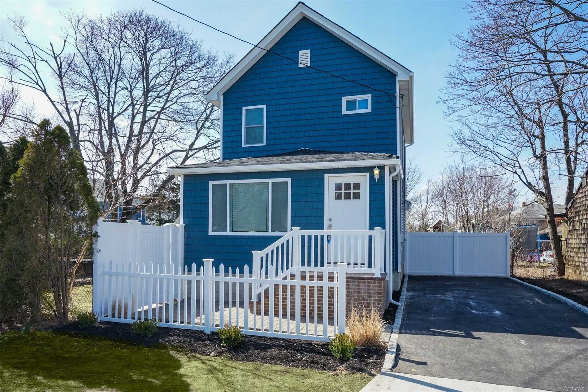 Renovated down to the studs and redone with high quality! Open Floor Plan with 2 Full Baths and Beautiful Kitchen with Quartz counter tops. 0.7 miles to the heart of Patchogue Village. Don't wait to see this house...priced to sell!