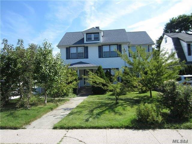 Lovely 1st floor appt . New kitchen, new bath, fireplace, finished basement, Deck in the rear. Parking spot in garage and 1 in driveway.