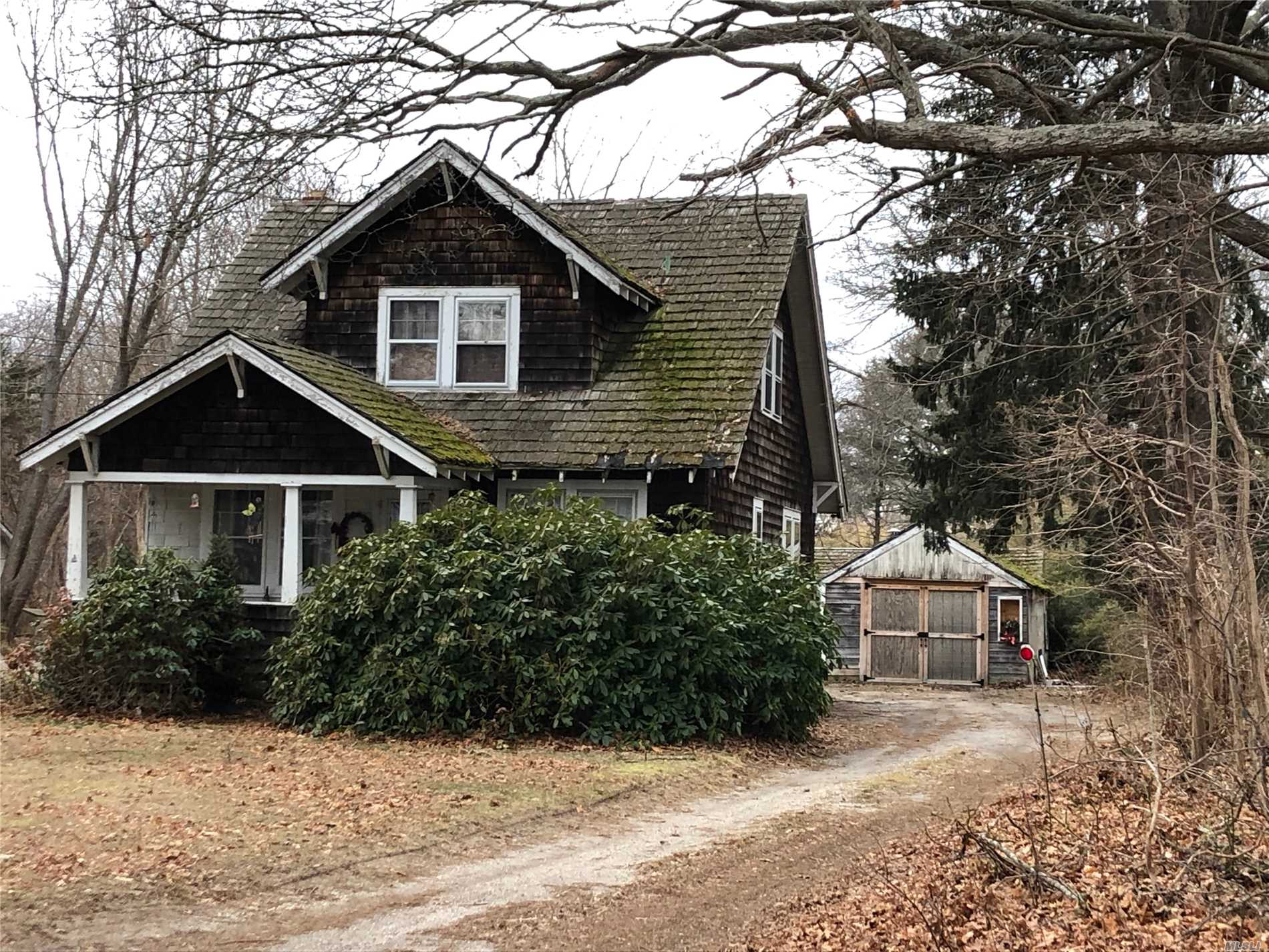 Large lot with Main house 2 car detached garage and a barn. This home is an investor or handyman's dream.