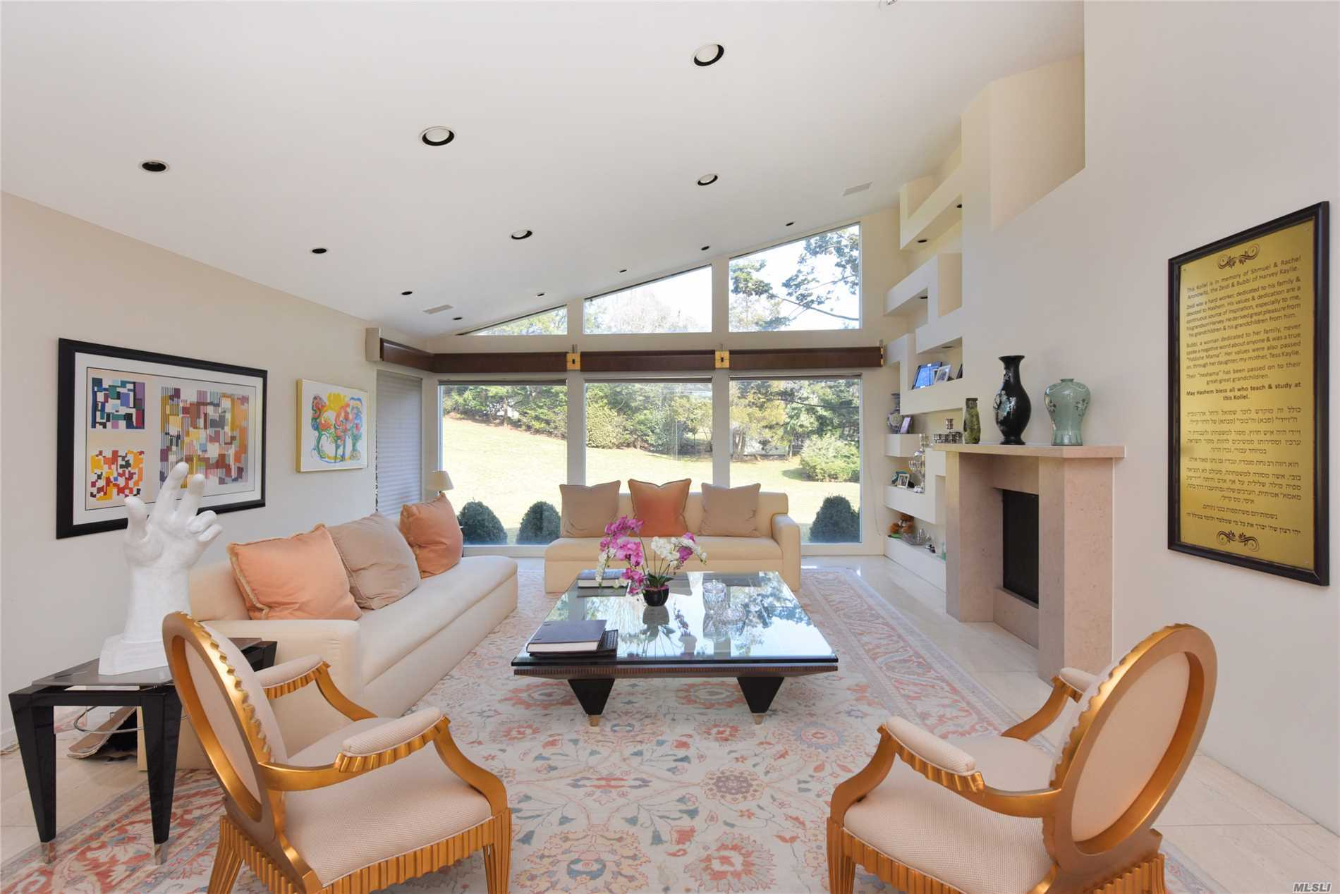 Natural light fills this contemporary style home with an airy open floor plan boasting 16 ft cathedral ceiling adjoining the LR & family room with double sided fpl in the center. Eat-in-kitchen features high-end appliances + prep island + custom cabinetry. Master on main includes his & her baths + WICs along with a 2nd ensuite BD + BD converted into an office. Two additional ensuite BDs on 2nd fl.Gym bar & playroom in basement. Beautifully manicured 1 acre property with in-ground pool and deck.