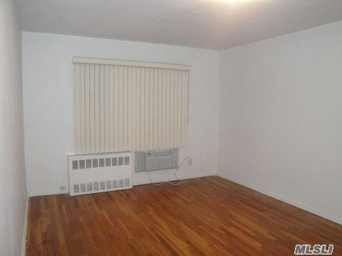 Large 2 Family Brick House, Faces South, School District 26, Near all Transportation, L.I.R.R., Northern Blvd., Shopping, Owner Motivated