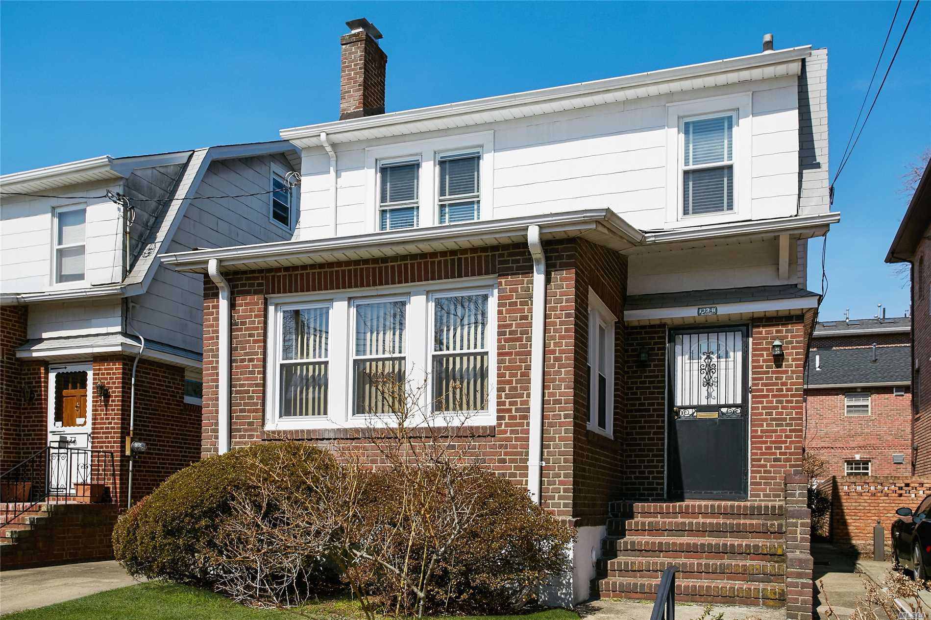 A Spacious and Bright Well Maintained Colonial. Featuring Formal Living Room with Fireplace, Formal Dining Room, Sun Room, Eat in Kitchen, 3 Bedrooms, 1 1/2 Baths, Walk-up Attic. Full Basement. Convenient to Shops and Public Transportation. Near LIRR Station. This Property is Sold AS IS. R3X Zoning