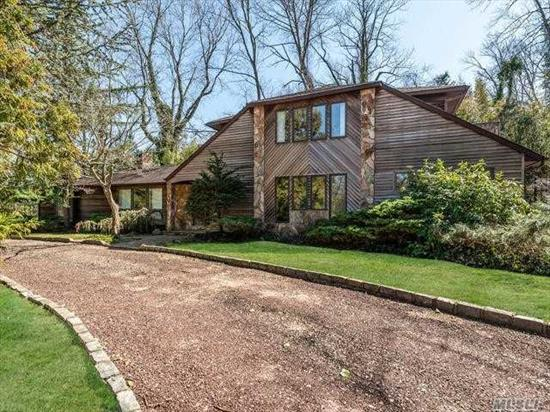 Generous half-acre wooded property with the house on eastern end leaving room for a deck and pool and maybe a tennis court. Secluded location and very private. Beach rights, HOA for snow plowing only