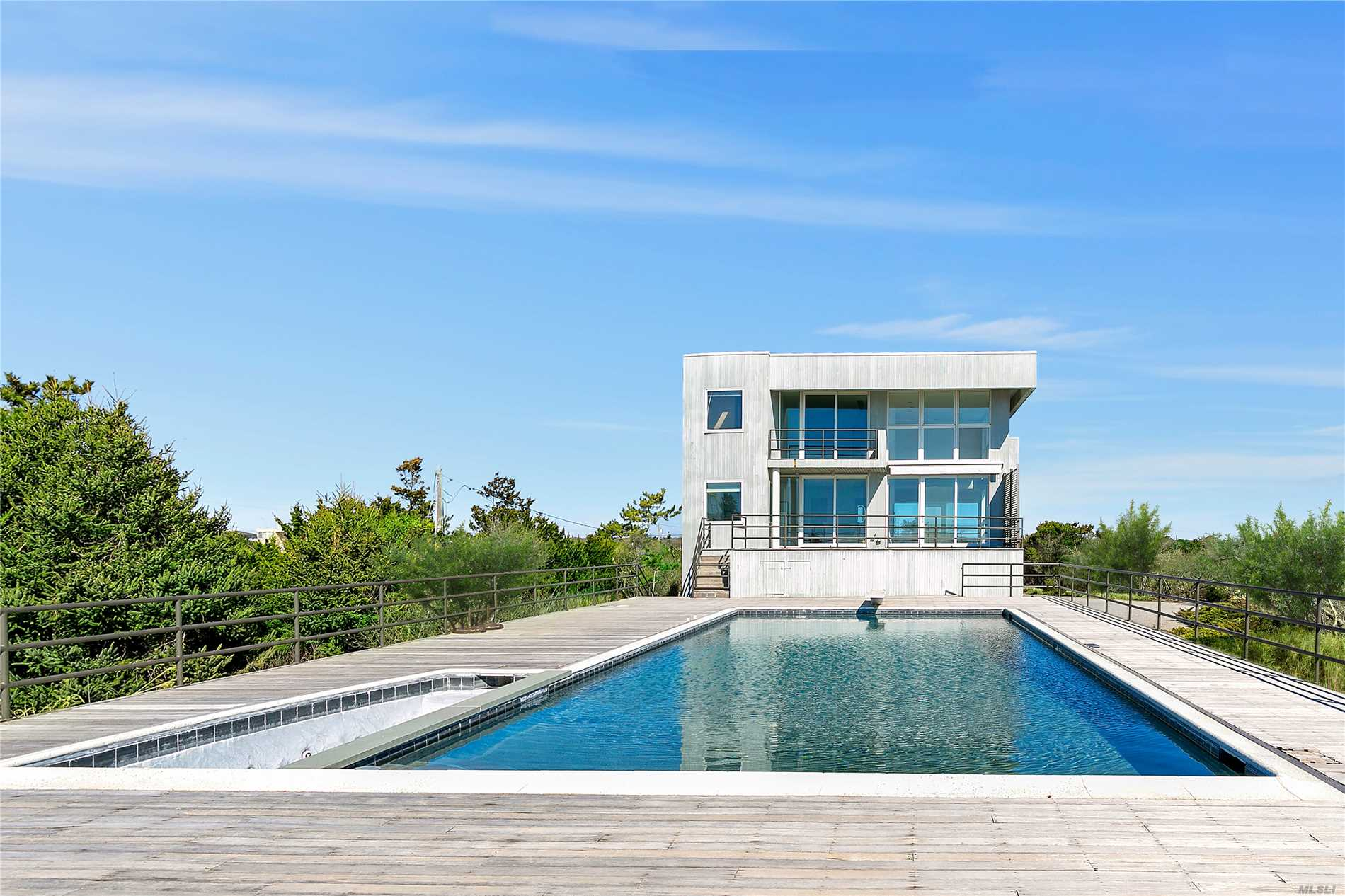A truly magnificent contemporary sited on over 2 acres of Quogue Oceanfront. This newly renovated 2, 500+/- sqft. home features a chef's kitchen w/ new appliances, 4 bedrooms, 4 baths, cabana bath, living & dining room, heated 20X40 oceanside gunite pool w/spa. With room for tennis and expansion, you can move in now or add to make it your dream Hampton's retreat!
